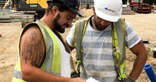 Mackoy Groundworks Operatives Studying Plans on Site