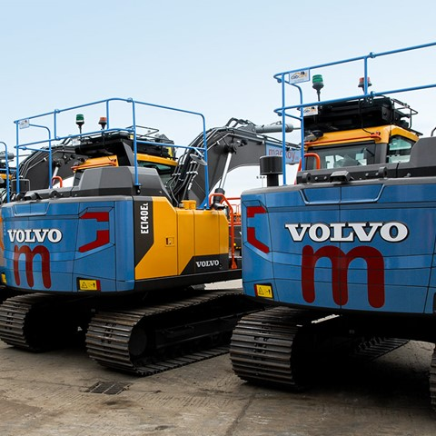 Mackoy Branded Plant Machinery Volvo Diggers Lined Up on Site