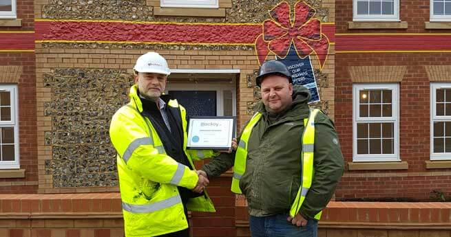 Foreman of the month November receiving his award from SHEQ manager
