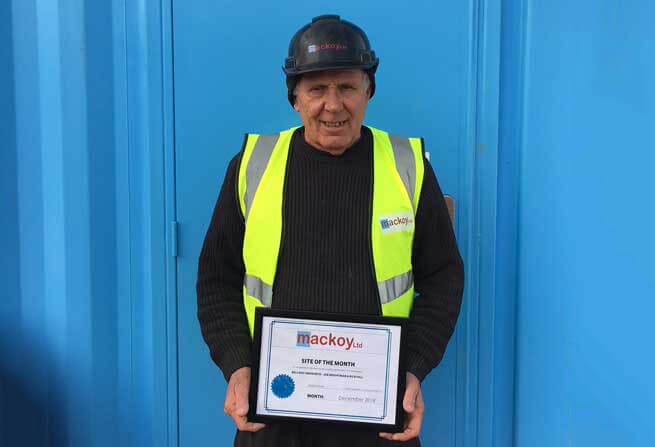 Site of the month December award winner standing in front of blue container